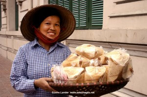 One of the most endearing sights of Hanoi is that of its ubiquitous vendors peddling baskets of crackers, fruit or baguettes through the streets. Whether sold from the back of a bicycle or baskets balanced on bamboo shoulder poles street vendors are a part of the Hanoi scene.